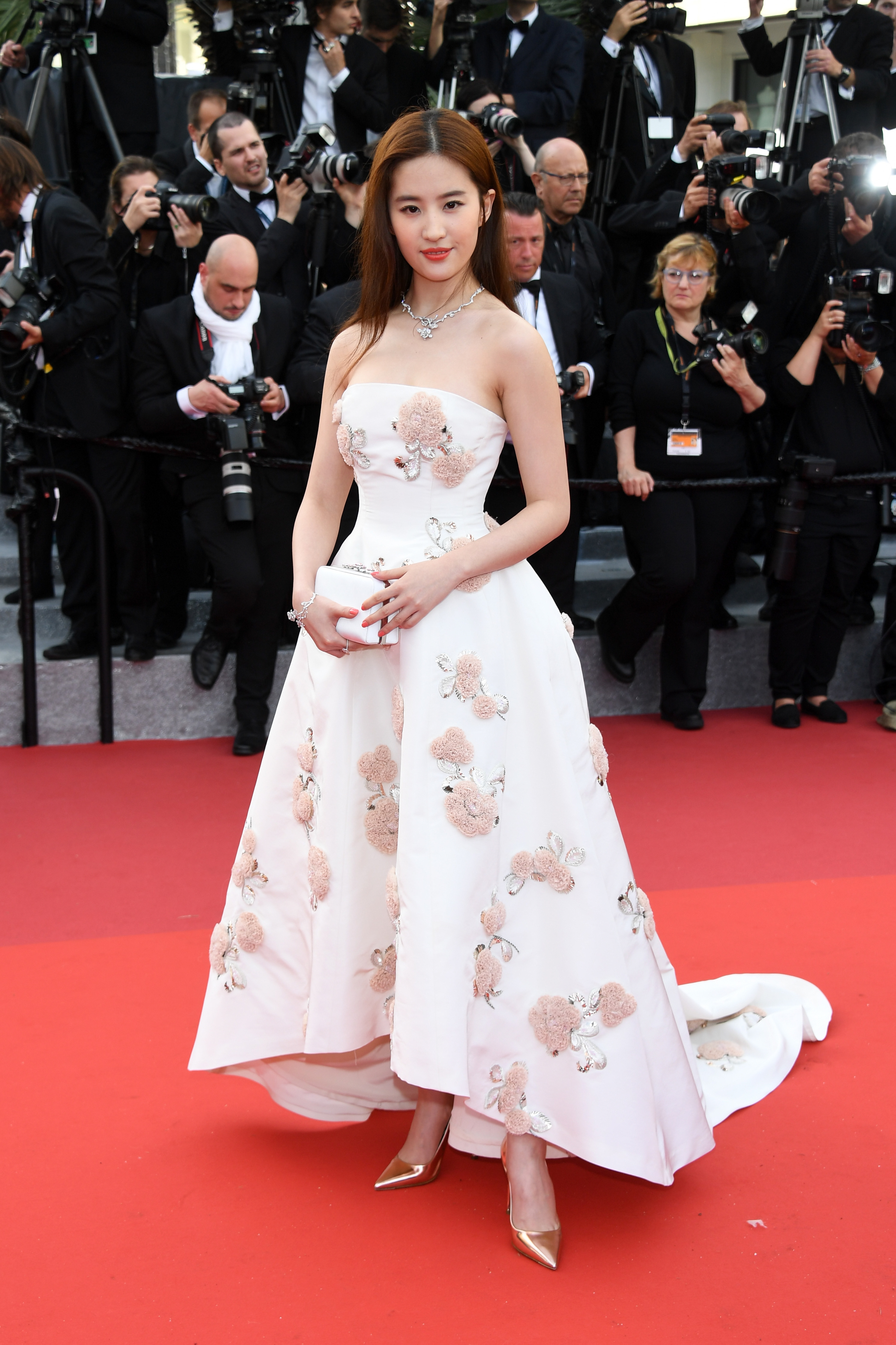 """CANNES, FRANCE - MAY 11: Actress Liu Yifei attends the """"Cafe Society"""" premiere and the Opening Night Gala during the 69th annual Cannes Film Festival at the Palais des Festivals on May 11, 2016 in Cannes, France. (Photo by Venturelli/WireImage)"""