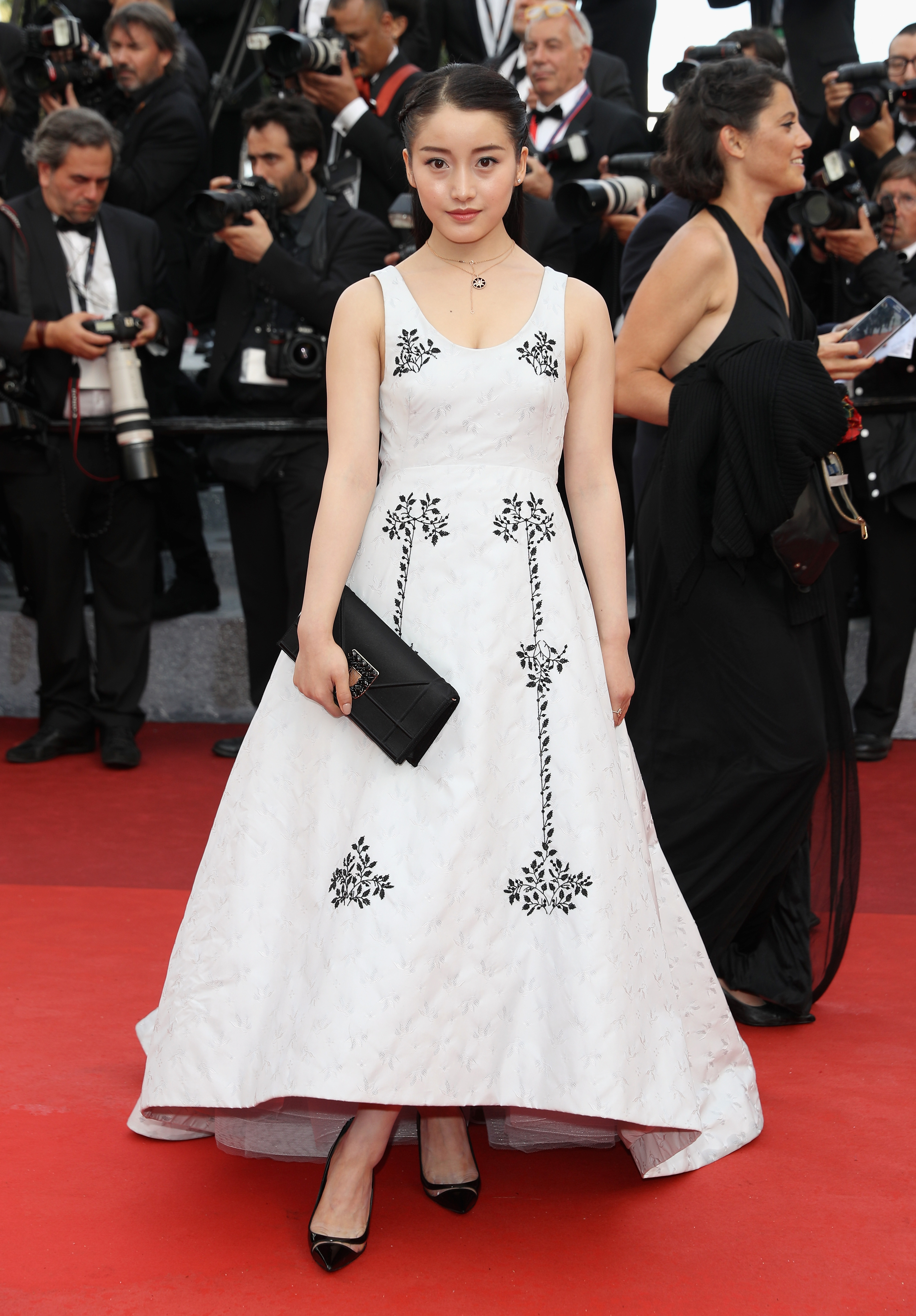 """CANNES, FRANCE - MAY 11: Yao Xin attends the """"Cafe Society"""" premiere and the Opening Night Gala during the 69th annual Cannes Film Festival at the Palais des Festivals on May 11, 2016 in Cannes, France. (Photo by Andreas Rentz/Getty Images)"""